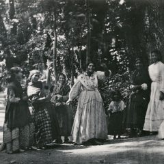 Group of Romani women and children in the Alhambra Forest in Granada, Andalusia