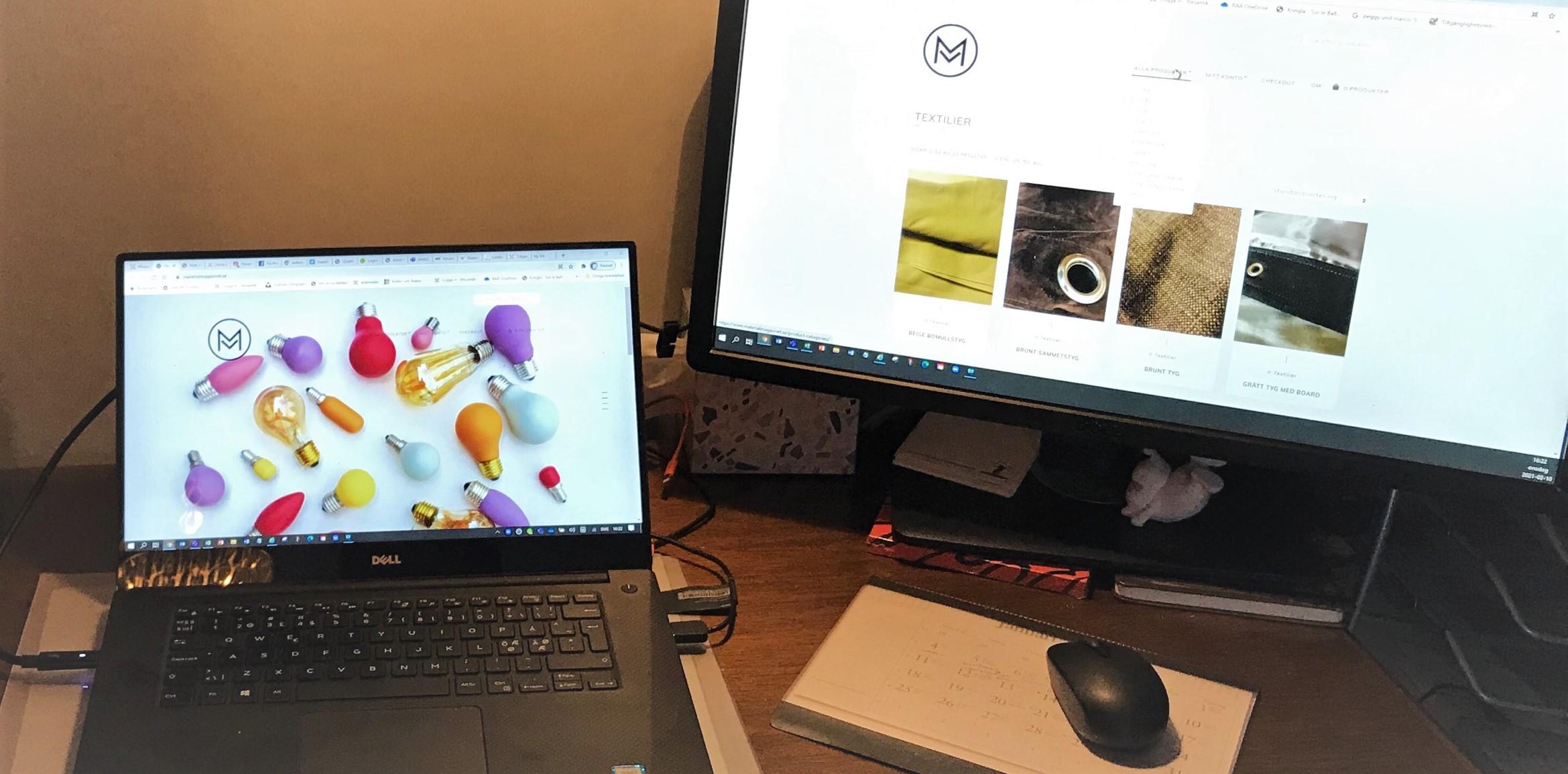 En liten laptop och en vanlig datorskärm. På den lilla syns fler aolika modeller av glödlampor i olika färger.